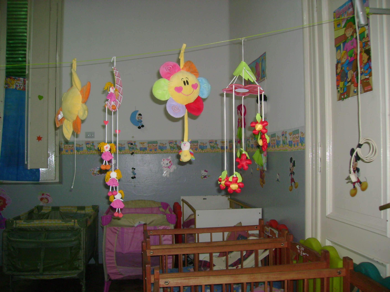 Jard n maternal huellitas 100 a os hnc for Asistenciero para jardin de infantes